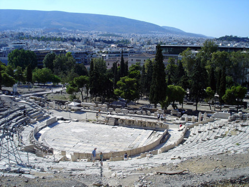 Present-day remains of the Theatre of Dionysus Eleuthereus; via Wiki Commons