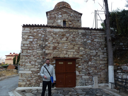 Vassilios in front of the Church of Metamorphosis, an 11th century Byzantine church on the slope of the Acropolis.