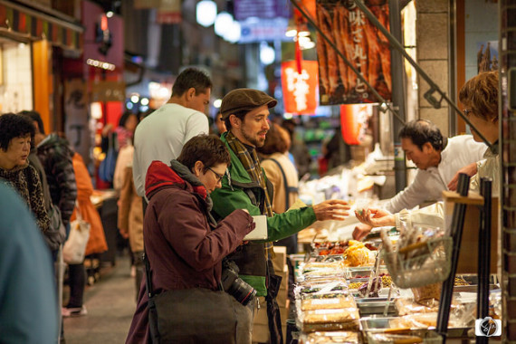 Food expert Daniel Milne sharing the delicacies of the Nishiki Market in Kyoto.  Photo courtesy of misadventureswithandi