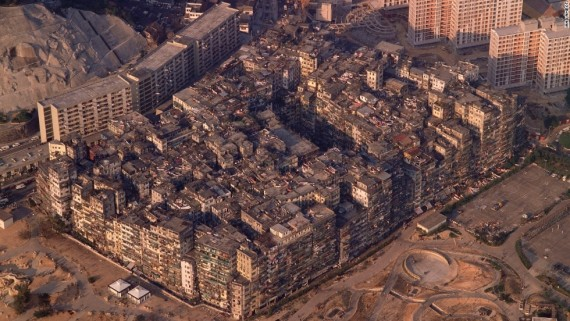 Kowloon Walled City This site began as a strategic point for Chinese imperial officials to manage trade and defend against pirates and foreign invasion. By 1847 the fort was reconstructed as a garrison-city and had a population of about 700. Following the lease of the New Territories to Britain in 1898 this enclave was governed neither by the Chinese nor the British leaving a vacuum of power behind: anarchy ensued as a result. According to our docent Walter Lee, there are many tales of gamblers, prostitutes, drug-dealers, illegal immigrants, gangs and doctors without licenses that occurred within the city walls during this period. Photo credit: Greg Girard and Ian Lambot