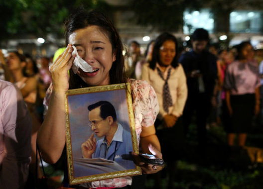 A woman reacts to the King's death. Credit: ATHIT PERAWONGMETHA / REUTERS